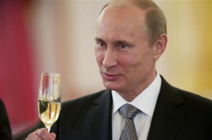 460424-russian-president-vladimir-putin-toasts-during-a-ceremony-in-which-the-diplomatic-credentials-of-new