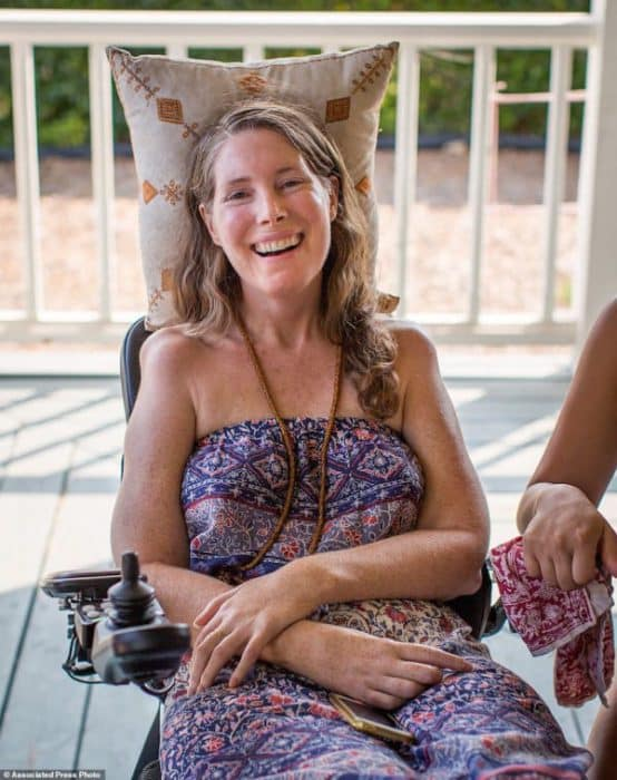 "This July 24, 2016 photo provided by Niels Alpert, Betsy Davis, smiles during a going away party with her family and friends in Ojai, Calif. In early July, Davis emailed her closest friends and family to invite them to a two-day celebration, telling them: ""These circumstances are unlike any party you have attended before, requiring emotional stamina, centeredness, and openness. And one rule: No crying."" Davis, diagnosed with ALS, held the party to say goodbye before becoming one of the first California residents to take life-ending drugs under a new law that gave such an option to the terminally ill. (Niels Alpert via AP)"