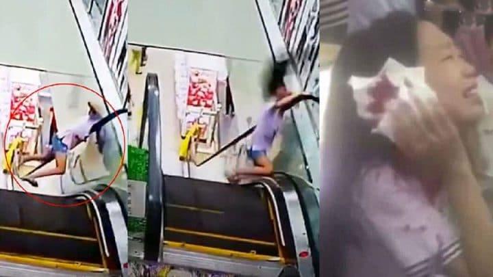 tête coincée entre rampe escalator mur