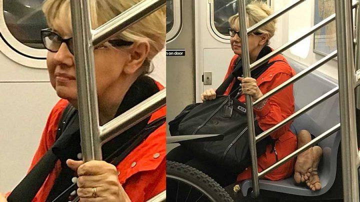 femme s'assied sur un sdf dans le métro new-yorkais
