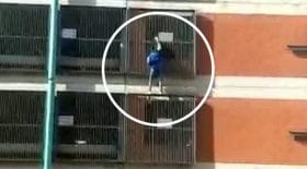 spider girl cascadeuse grimpe façade