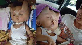 bébé cornes de diables sur la tête
