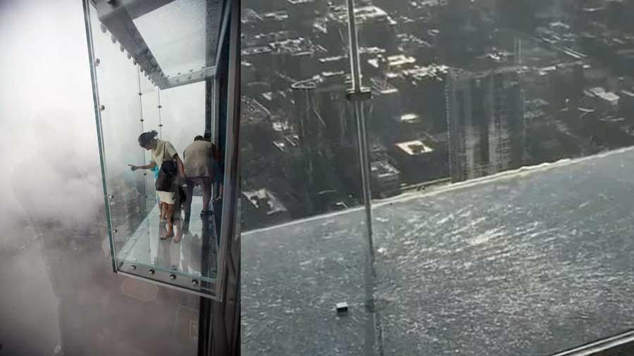 Le balcon en verre au 103e étage d'une tour à Chicago se fissure avec des touristes dessus