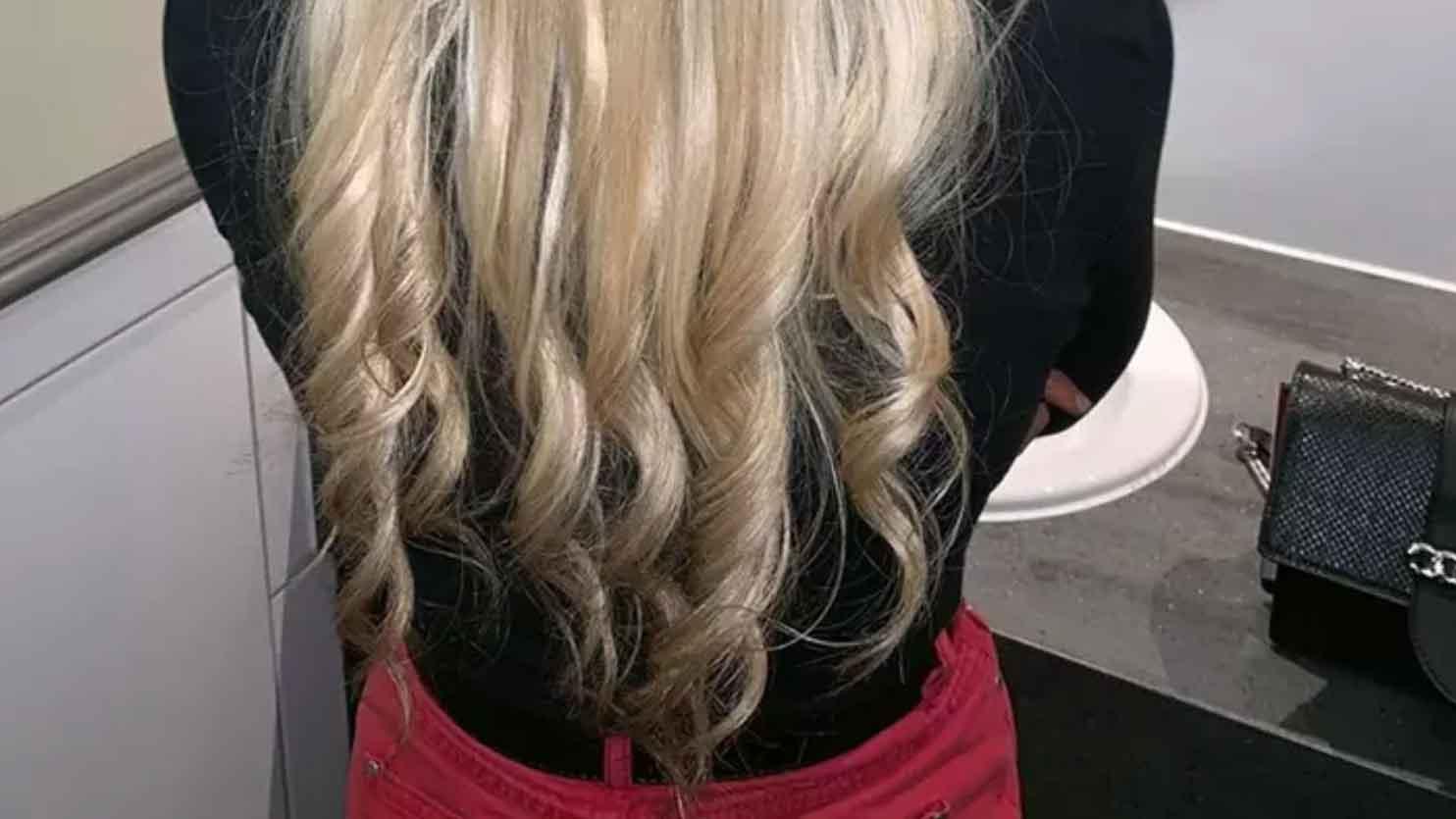 Elle utilise les tuyaux du radiateur pour se boucler les cheveux et le résultat est bluffant